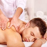 Female Massage Therapist performing Shiatsu massage technique on a male patient.