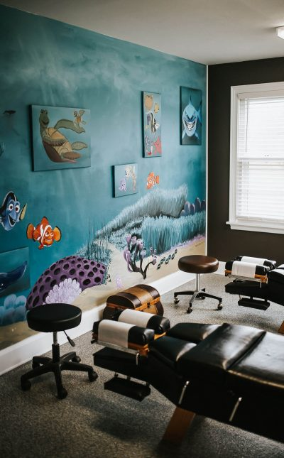 View of a decorated painted wall inside the Spectrum Chiropractic and Health office.